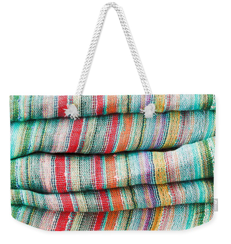 Backdrop Weekender Tote Bag featuring the photograph Colorful Cloth by Tom Gowanlock