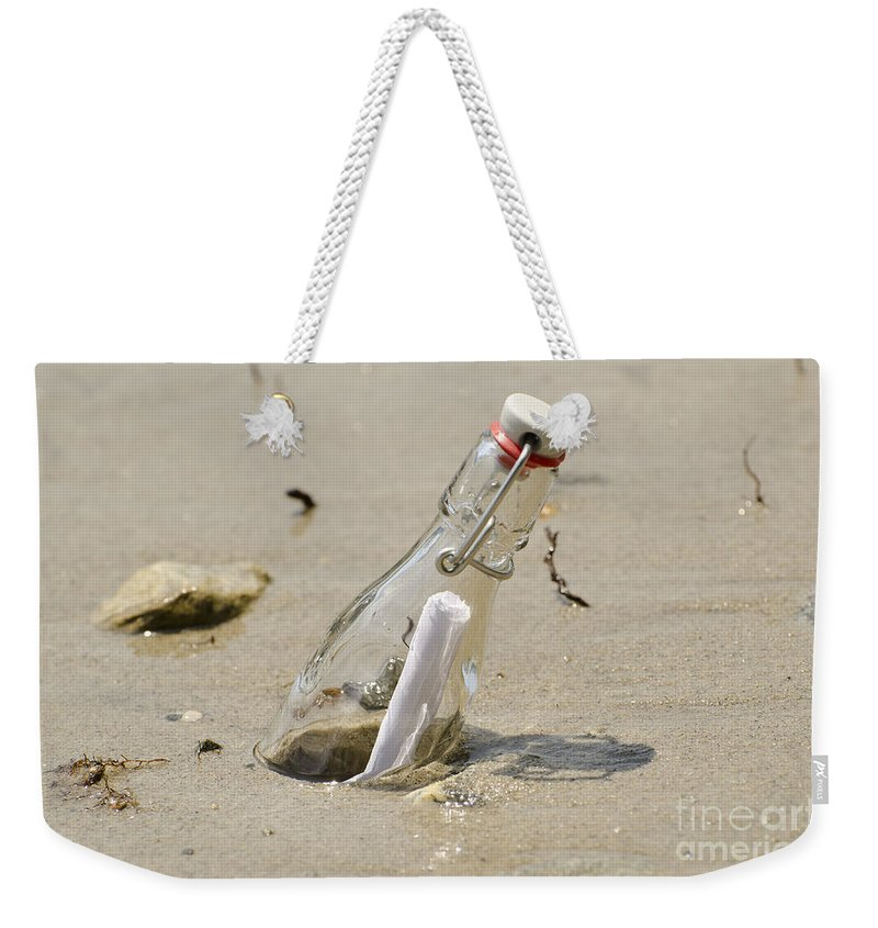 Message Weekender Tote Bag featuring the photograph Message In A Bottle by Mats Silvan