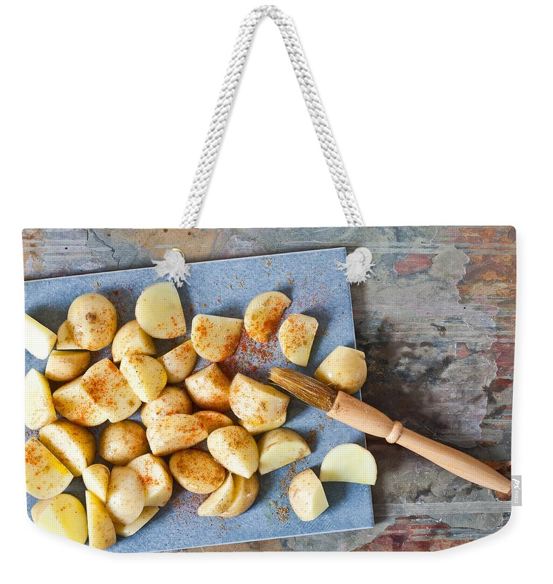 Basting Weekender Tote Bag featuring the photograph Potatoes by Tom Gowanlock