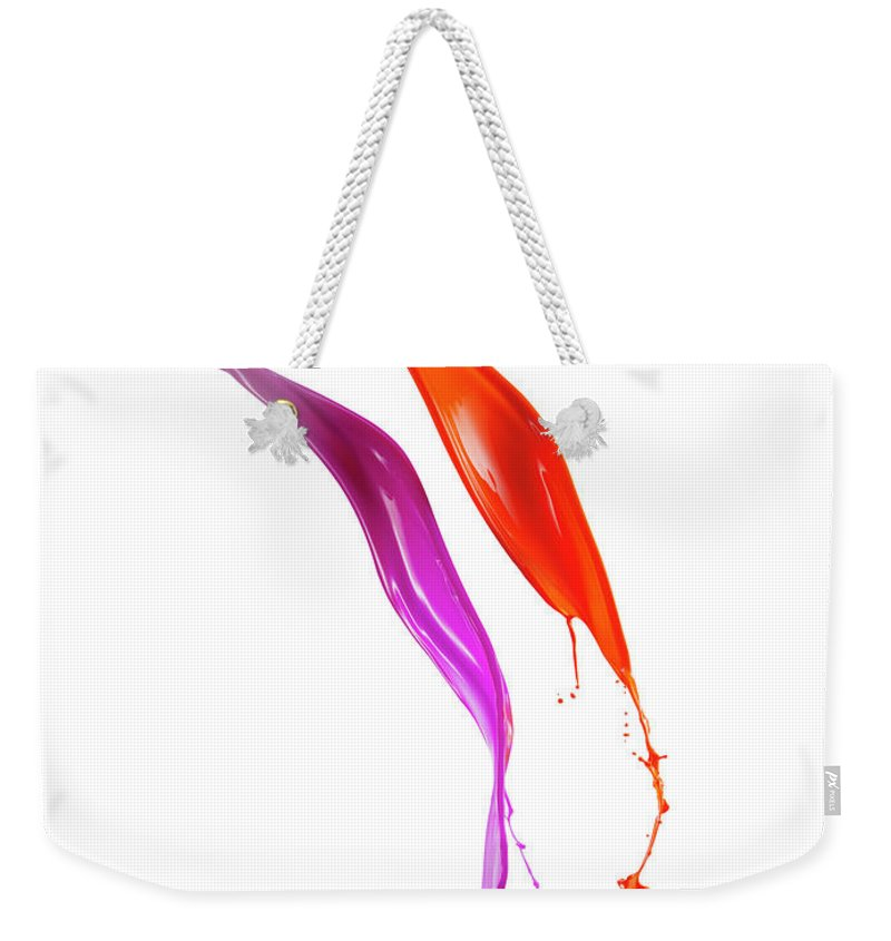 Orange Color Weekender Tote Bag featuring the photograph Splashing Of The Color Paint by Level1studio