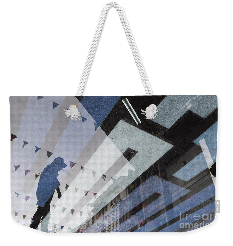 Blue Weekender Tote Bag featuring the photograph April Rain by Setsiri Silapasuwanchai