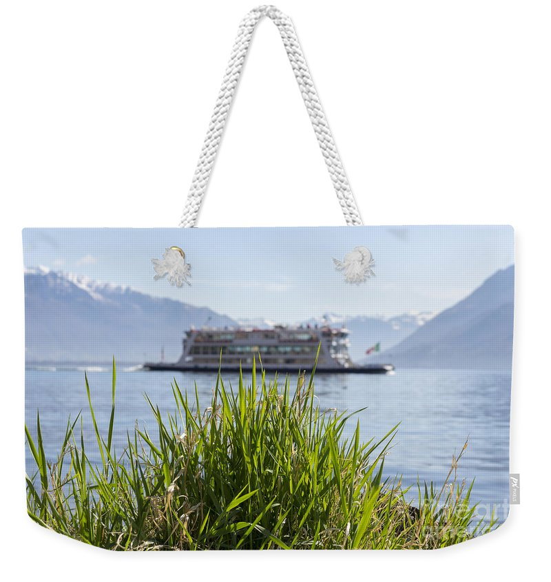 Passenger Ship Weekender Tote Bag featuring the photograph Passenger Ship On An Alpine Lake by Mats Silvan