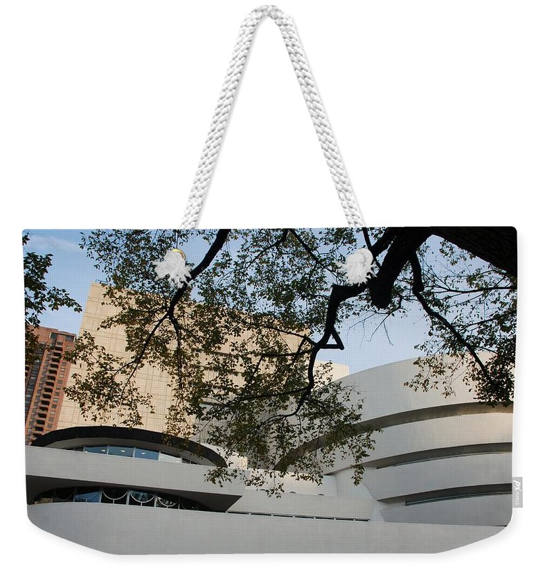 Scenic Weekender Tote Bag featuring the photograph The Guggenheim by Rob Hans
