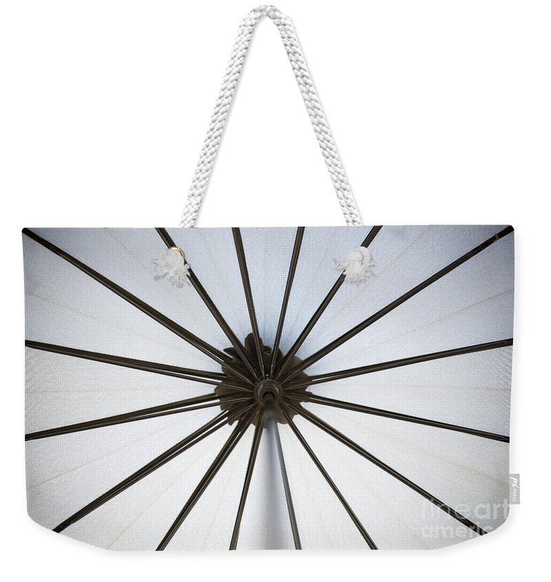 Umbrella Weekender Tote Bag featuring the photograph Umbrella by Mats Silvan