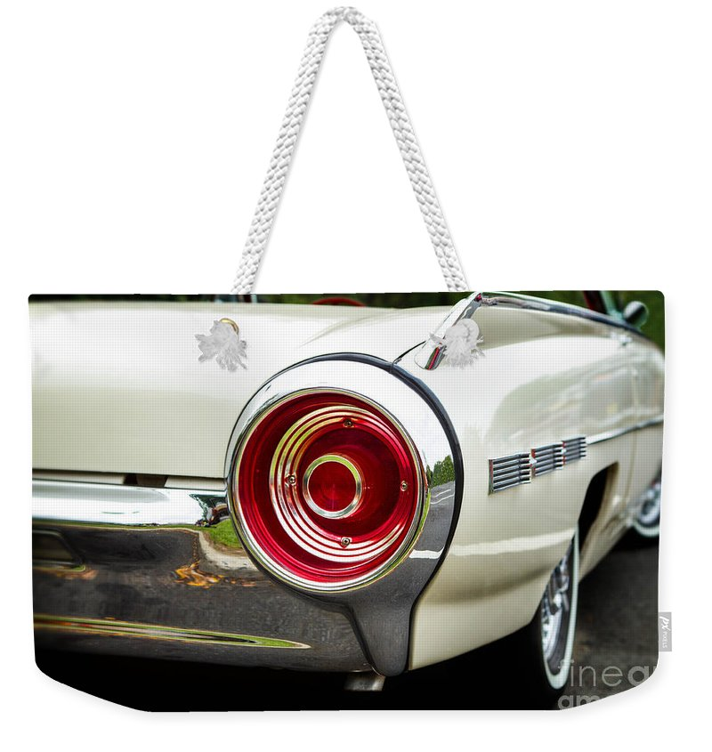 1962 Weekender Tote Bag featuring the photograph 62 Thunderbird Tail Light by Jerry Fornarotto