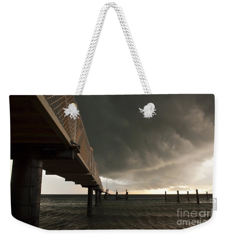 Beach Weekender Tote Bag featuring the photograph Storm Clouds by Tim Hester