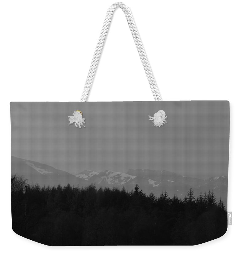 Blue Sky Weekender Tote Bag featuring the photograph Treeline With Ice Capped Mountains In The Scottish Highlands by Ashish Agarwal