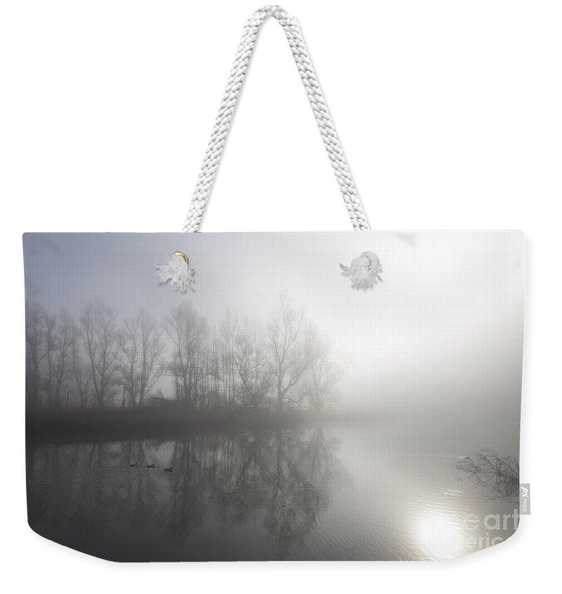 Lake Weekender Tote Bag featuring the photograph Foggy Lake by Mats Silvan