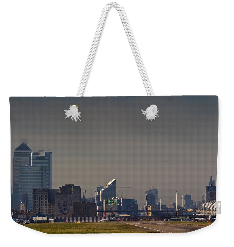 London Weekender Tote Bag featuring the photograph London City Airport by David Pyatt
