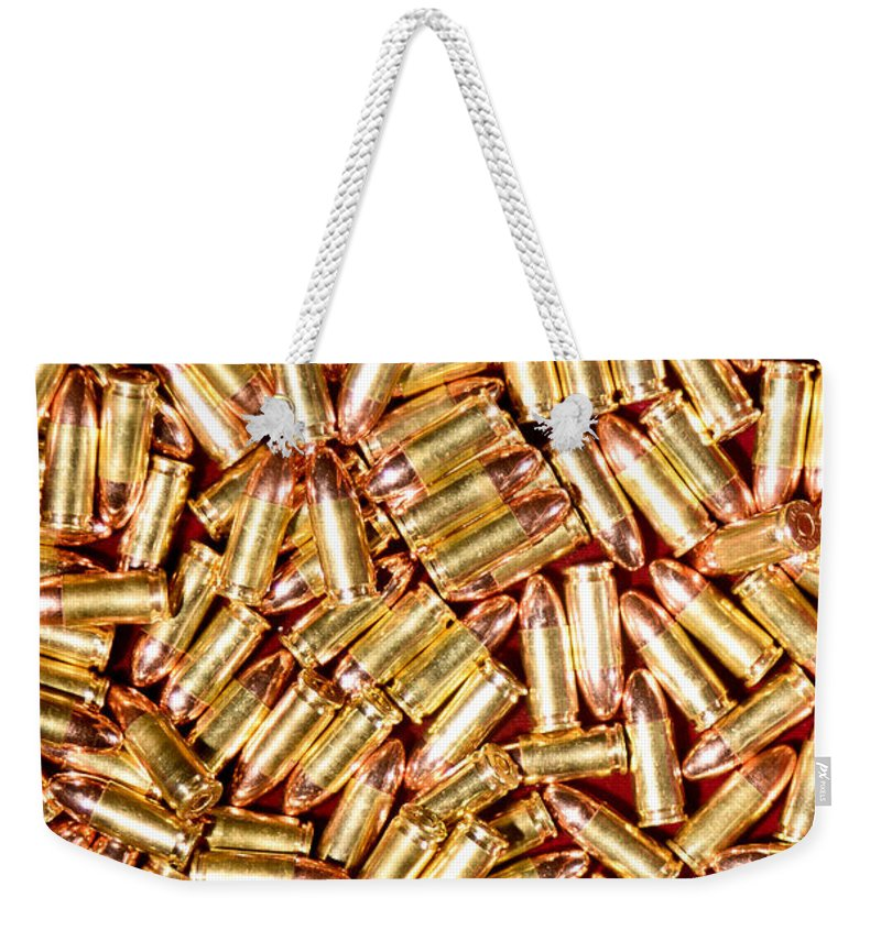 Gun Weekender Tote Bag featuring the photograph 9mm Brass Ammo by Jt PhotoDesign
