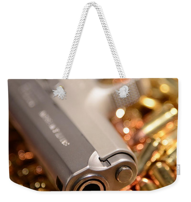 Gun Weekender Tote Bag featuring the photograph 9mm Sw With Brass by Jt PhotoDesign