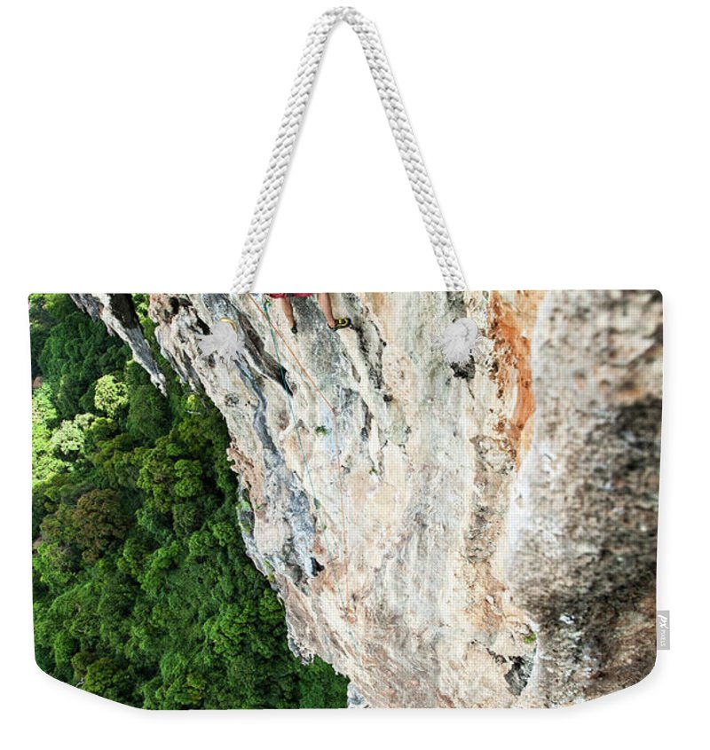25-29 Years Weekender Tote Bag featuring the photograph A Athletic Man Rock Climbing High by Patrick Orton