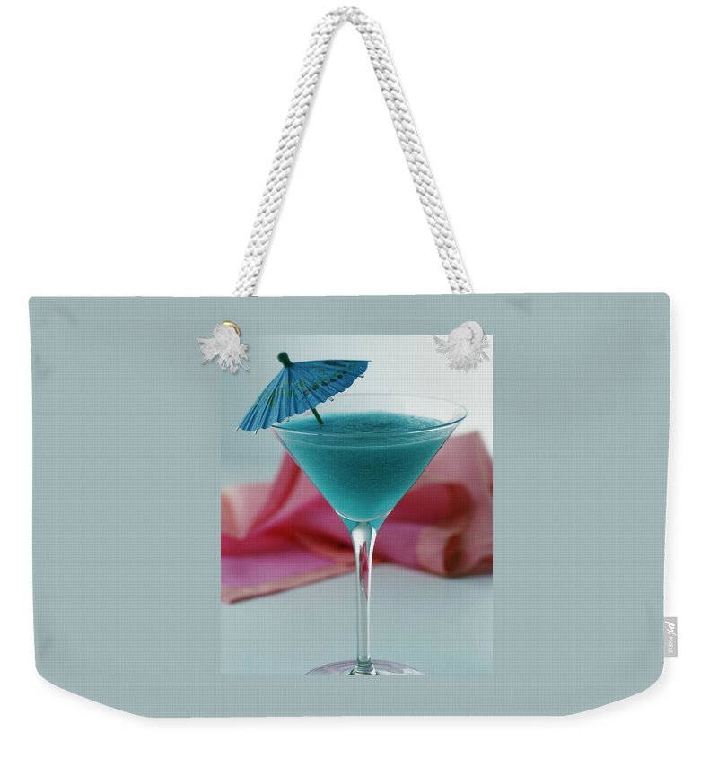 Beverage Weekender Tote Bag featuring the photograph A Blue Hawaiian Cocktail by Romulo Yanes