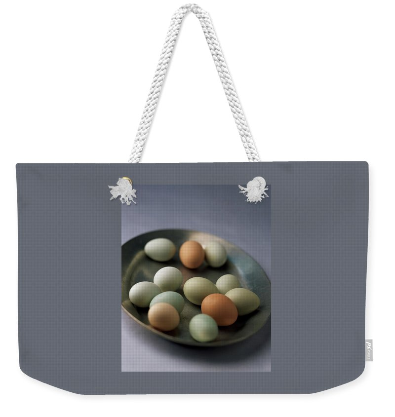 Cooking Weekender Tote Bag featuring the photograph A Bowl Of Eggs by Romulo Yanes