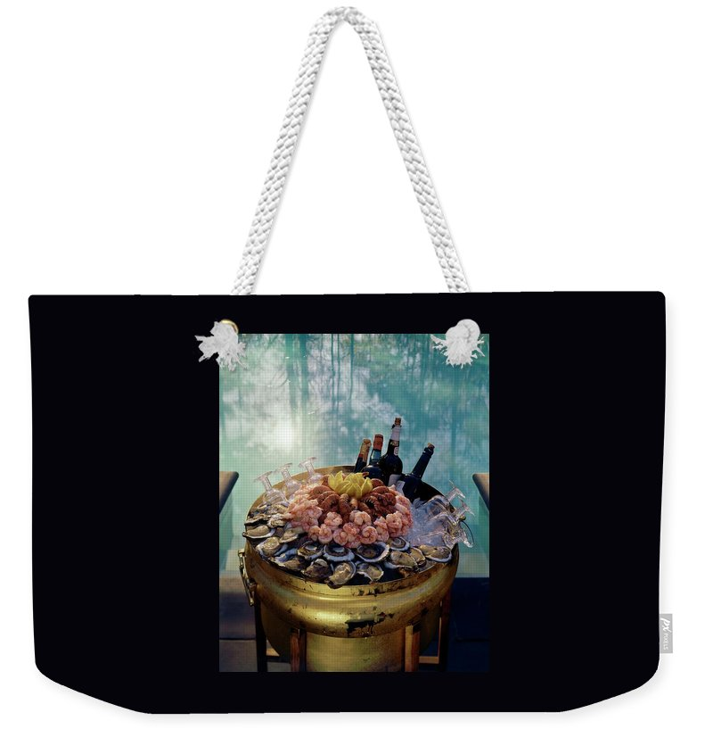 Nobody Weekender Tote Bag featuring the photograph A Bucket Of Shrimp by Ernst Beadle