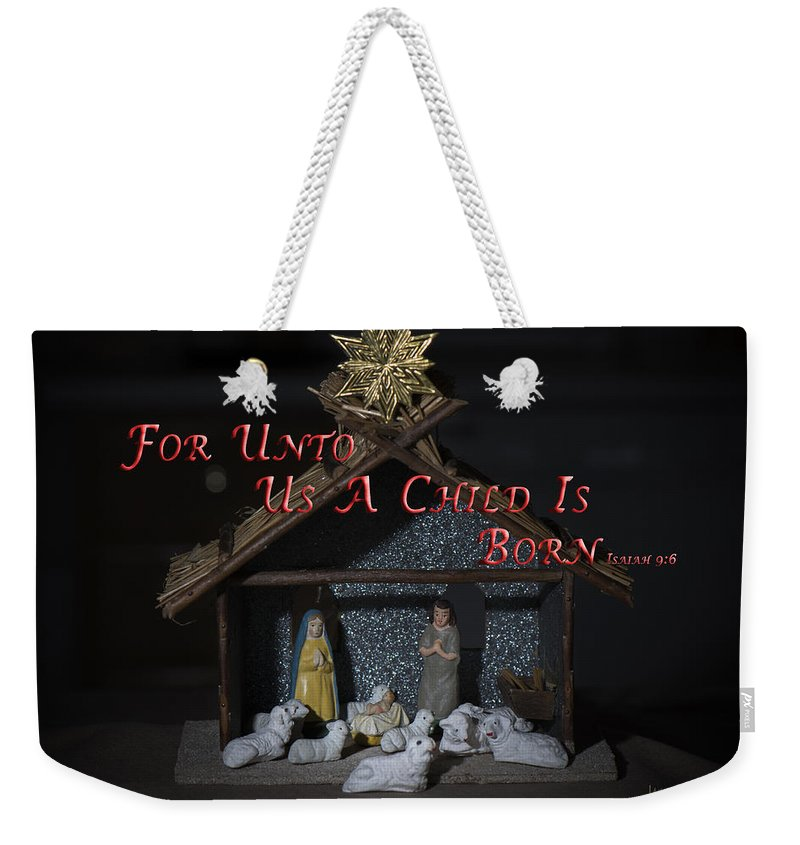 Christmas Weekender Tote Bag featuring the photograph A Child Is Born by Jayne Gohr