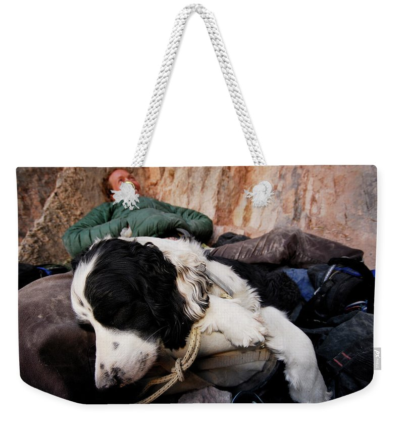 Adult Weekender Tote Bag featuring the photograph A Climber And Her Dog Lay by Rich Wheater