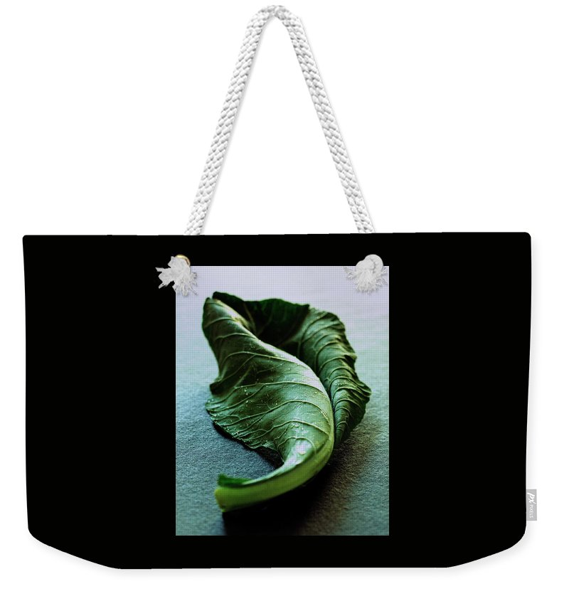 Nobody Weekender Tote Bag featuring the photograph A Collard Leaf by Romulo Yanes