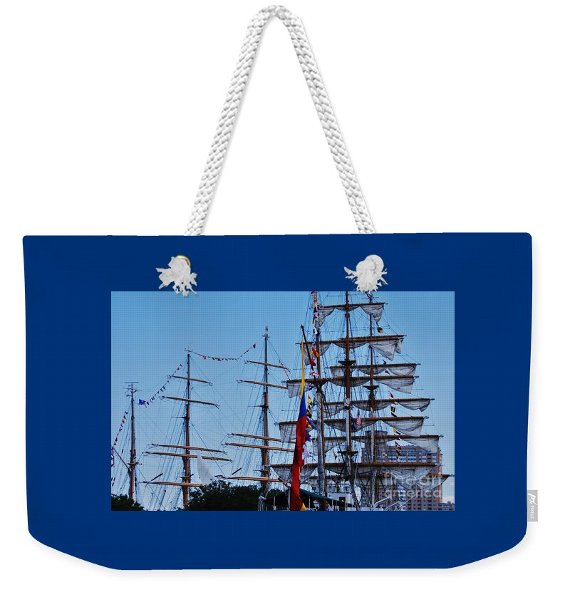 Maritime Art Tall Ship Nautical Subject Stock Shot Baltimore Harbor Inner Harbor Masts Rigging Outdoors Celebration Bunting Flags Masts Spars Harbor Place Tower Building Canvas Print Metal Frame Wood Print Poster Print Available On Pouches T Shirts Shower Curtains Phone Cases Mugs Tote Bags Pouches And Weekender Tote Bags Weekender Tote Bag featuring the photograph A Collection Of Masts In Baltimore by Marcus Dagan