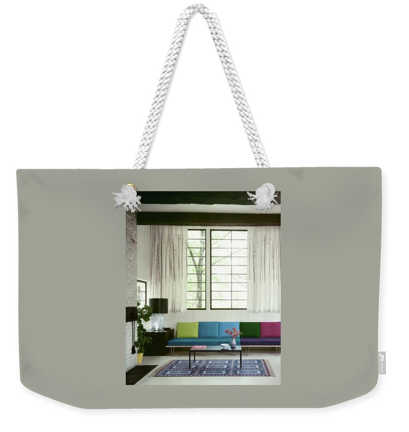 Wolfgang Fyler Weekender Tote Bag featuring the photograph A Colourful Living Room by Wiliam Grigsby