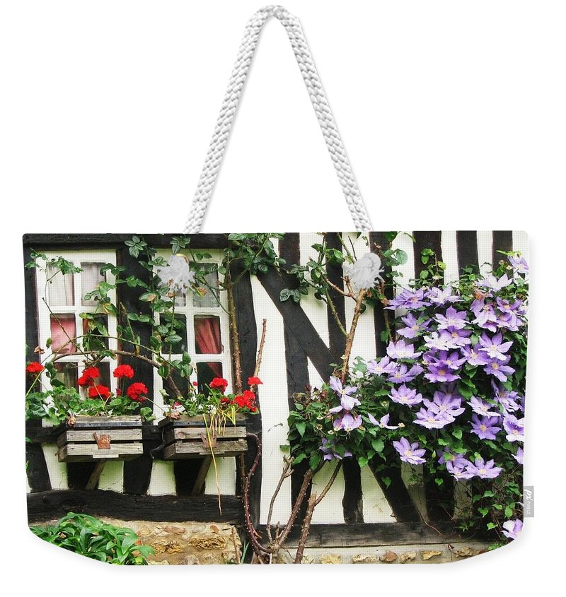 Cottage Weekender Tote Bag featuring the photograph A Cottage In Normandy by Mary Ellen Mueller Legault
