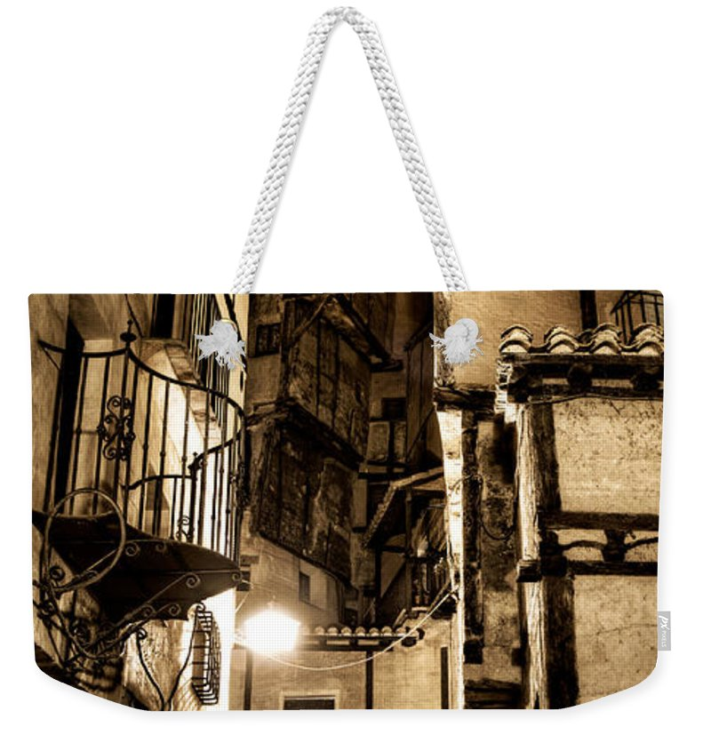 Albarracin Weekender Tote Bag featuring the photograph A Couple In A Little Restaurant In The Ancient City Of Albarracin by Weston Westmoreland