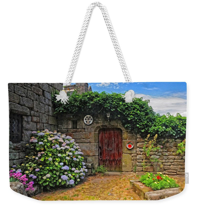 French Courtyard Weekender Tote Bag featuring the photograph A Courtyard In Brittany France by Dave Mills
