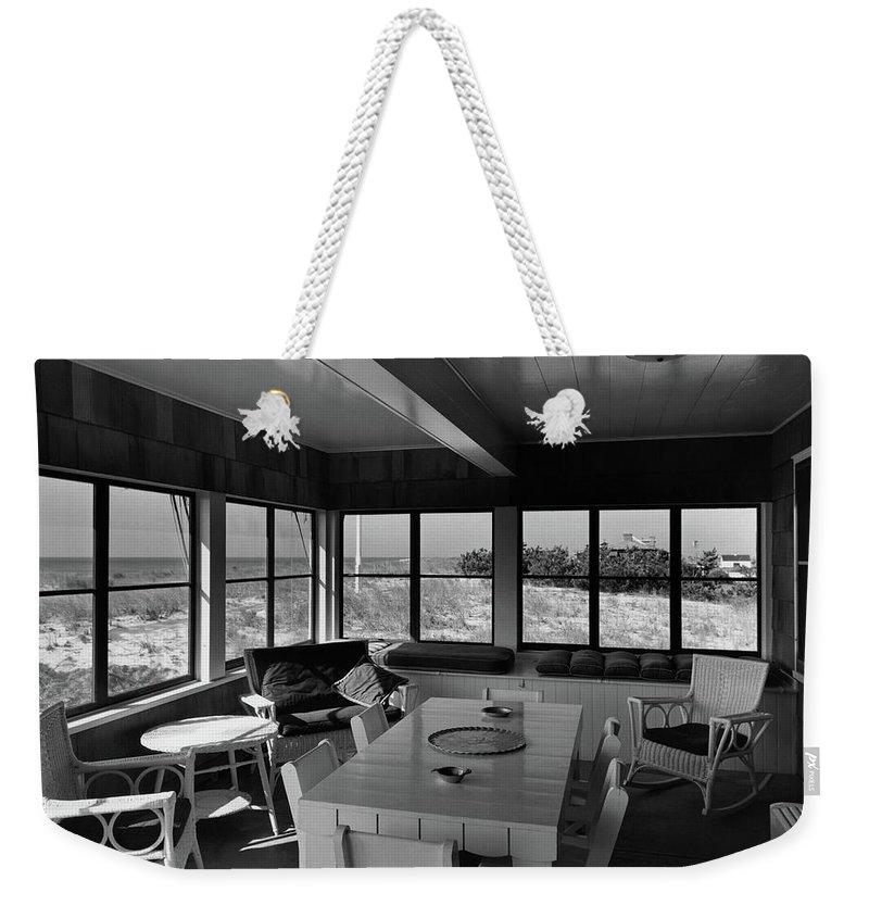 Home Weekender Tote Bag featuring the photograph A Covered Porch With A View by Gottscho-Schleisner