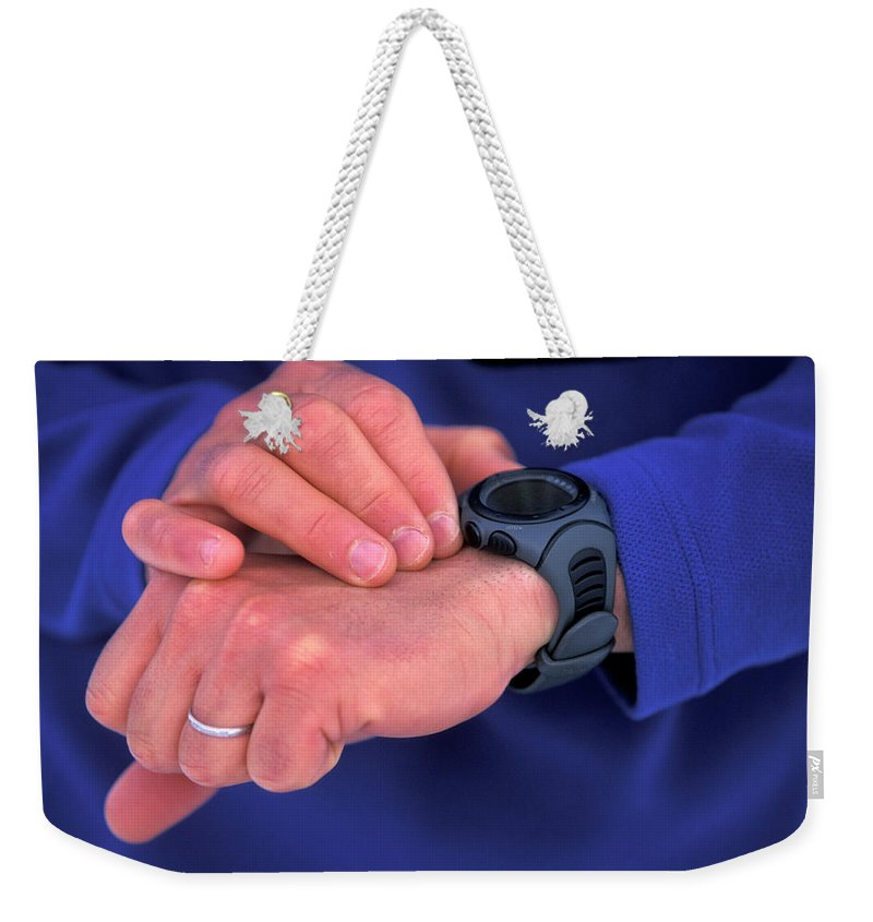 Blue Shirt Weekender Tote Bag featuring the photograph A Detail Shot Of A Man Checking by Corey Rich