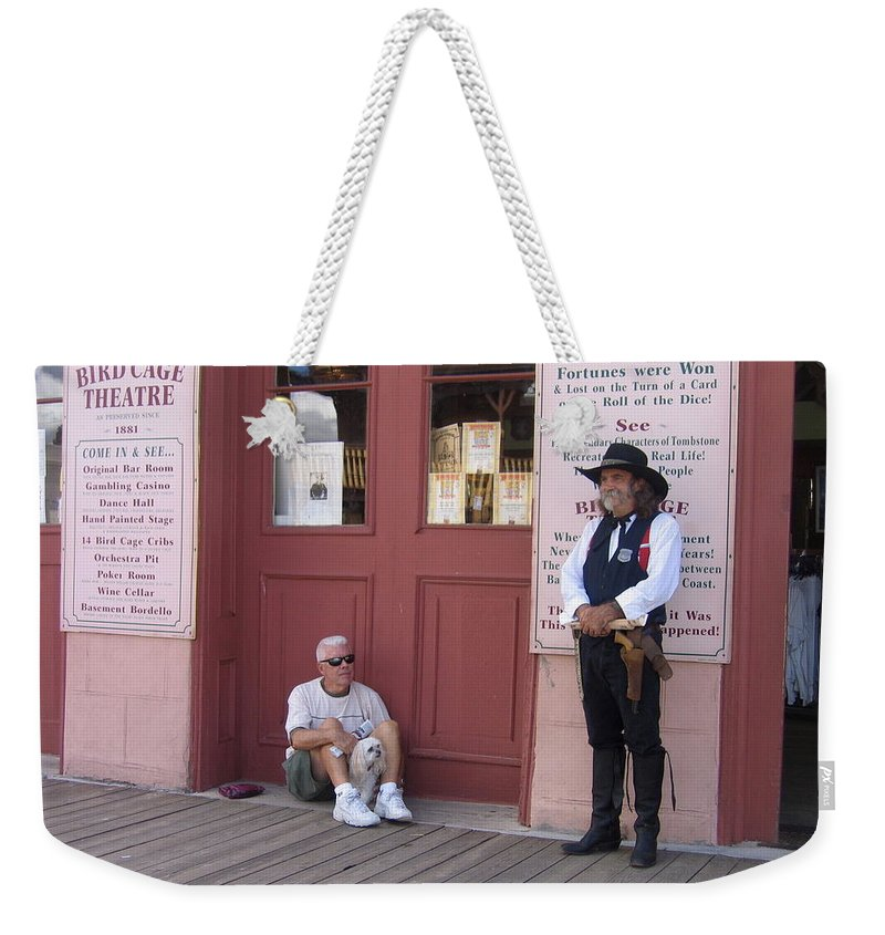 Dog Re-enactor Bird Cage Theater Tombstone Arizona Rendezvous Of The Gunfighters Weekender Tote Bag featuring the photograph A Dog And A Re-enactor Rest In The Front Of The Bird Cage Theater Tombstone Arizona by David Lee Guss