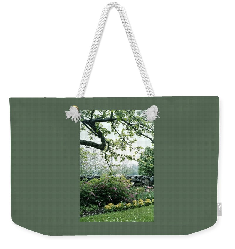 Nobody Weekender Tote Bag featuring the photograph A Flower Bed In Mrs. Frank Audibert's Garden by Samuel H. Gottscho