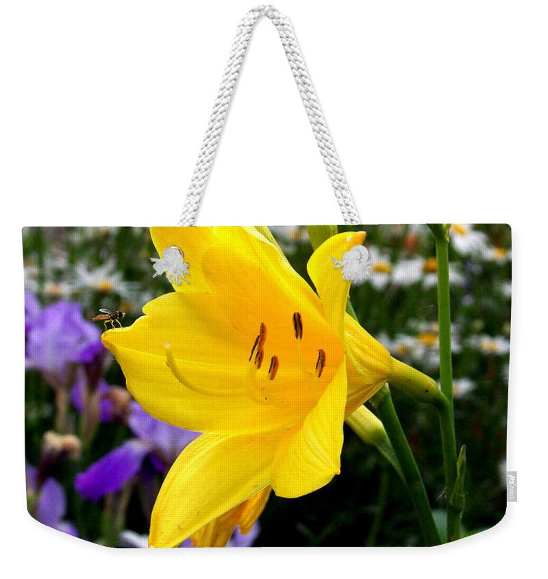 Lily Weekender Tote Bag featuring the photograph A Fly In The Ointment by Kathy McClure