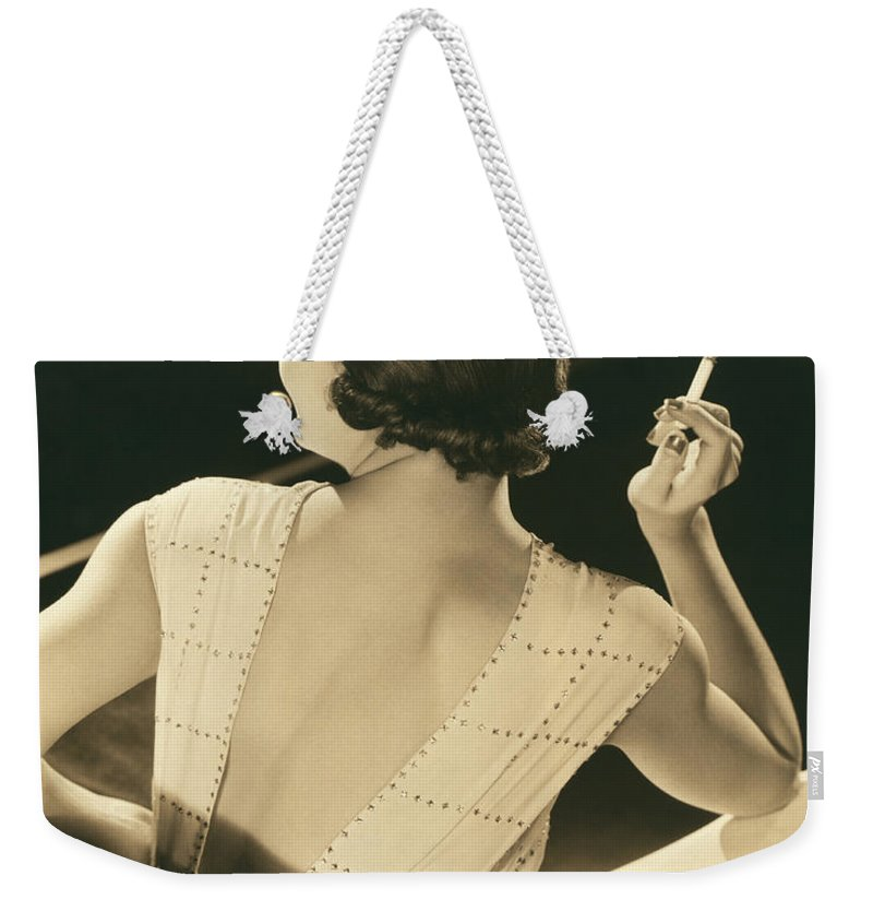1932 Weekender Tote Bag featuring the photograph A Glamourous Woman Smoking by Underwood Archives