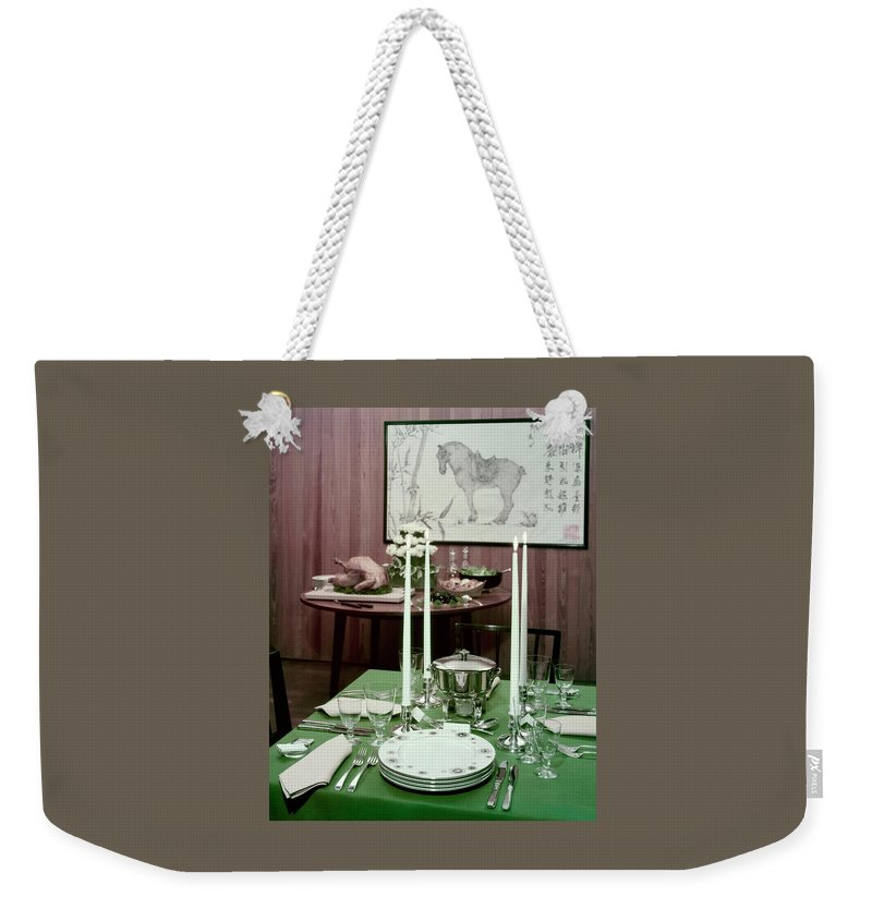 Indoors Weekender Tote Bag featuring the photograph A Green Table by Wiliam Grigsby