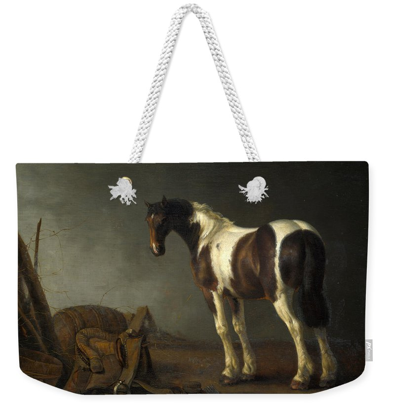 Abraham Van Calraet Weekender Tote Bag featuring the painting A Horse With A Saddle Beside It by Abraham van Calraet