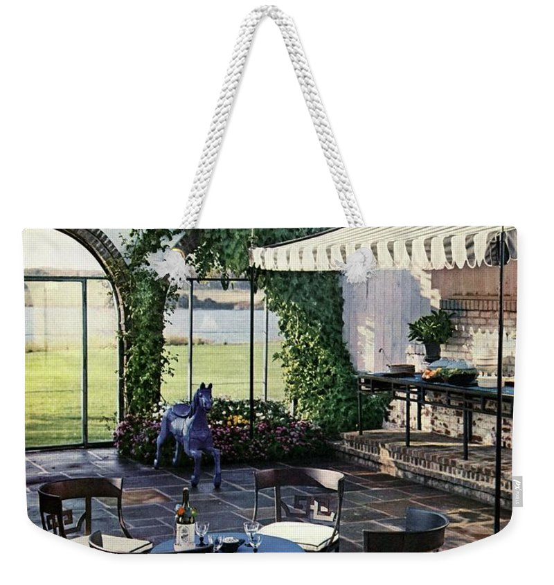 Magazine Weekender Tote Bag featuring the photograph A House And Garden Cover Of A Terrace In East by Wiliam Grigsby