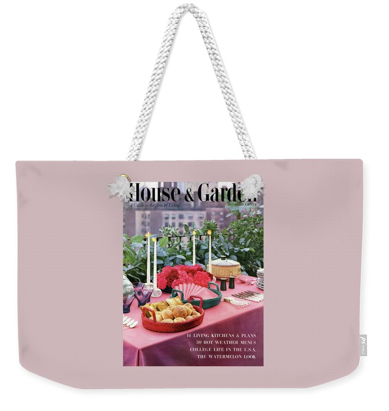 Travel Weekender Tote Bag featuring the photograph A House And Garden Cover Of Al Fresco Dining by Wiliam Grigsby