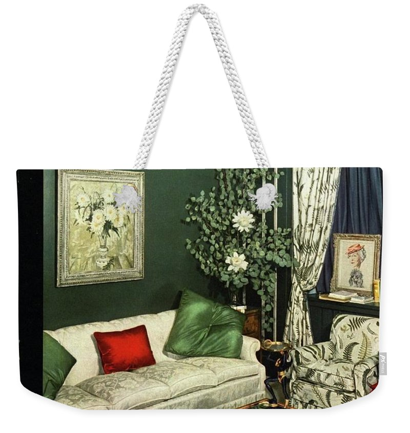 Home Accessories Weekender Tote Bag featuring the photograph A House And Garden Cover Of Lady Mendl's Sitting by Urban Weis