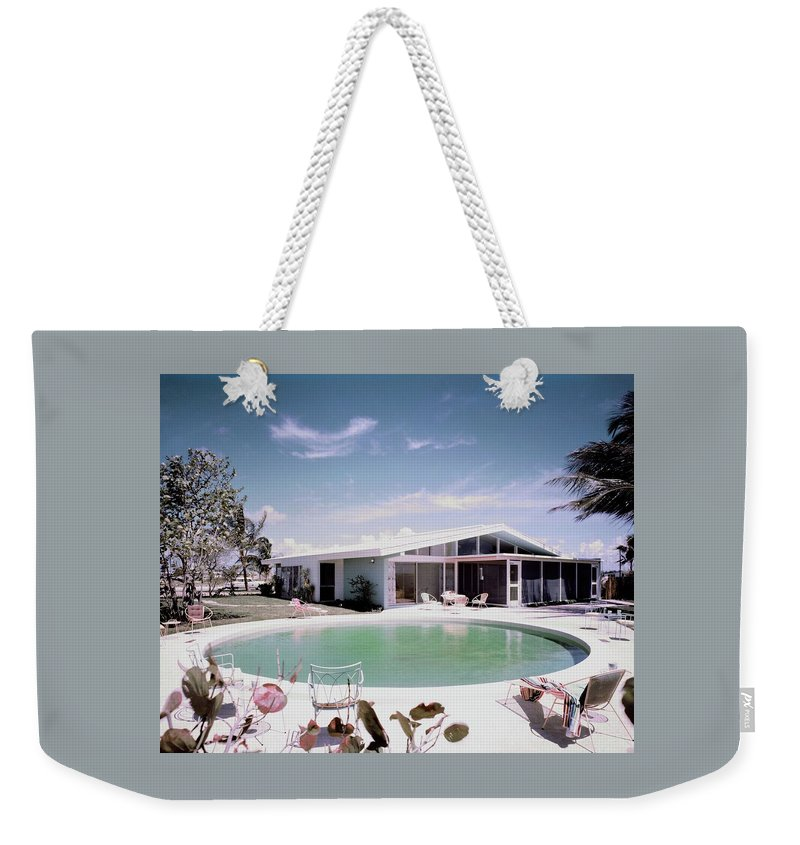 Miami Weekender Tote Bag featuring the photograph A House In Miami by Tom Leonard