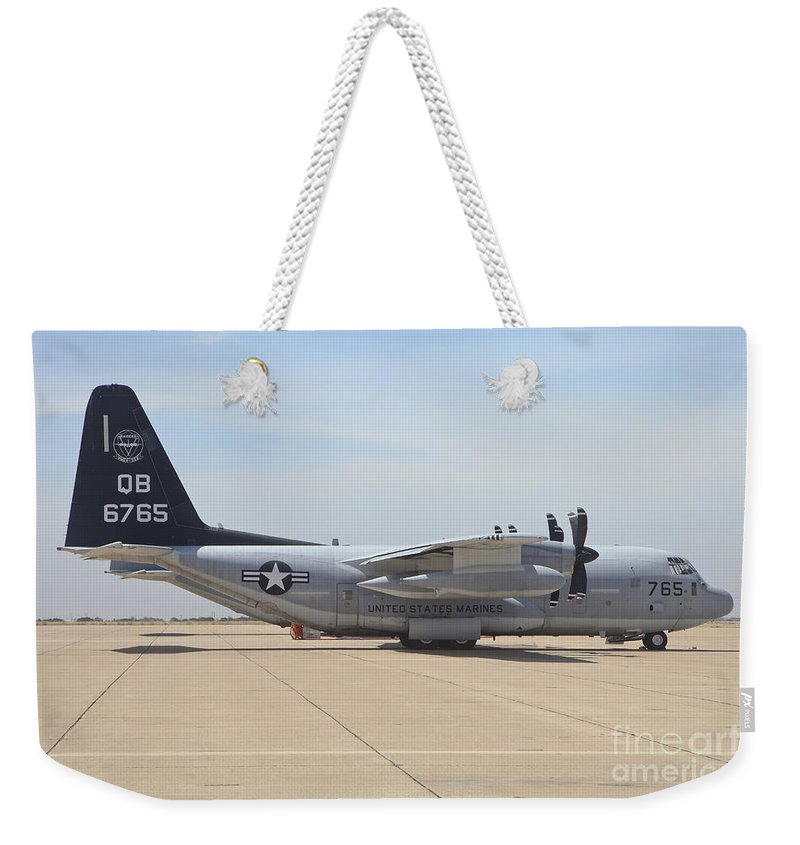 Horizontal Weekender Tote Bag featuring the photograph A Kc-130j Hercules At Marine Corps Air by Timm Ziegenthaler