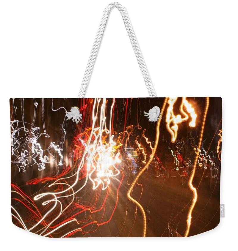 Light Photography Weekender Tote Bag featuring the photograph A Light Dance In Old Town by Jemel Smith