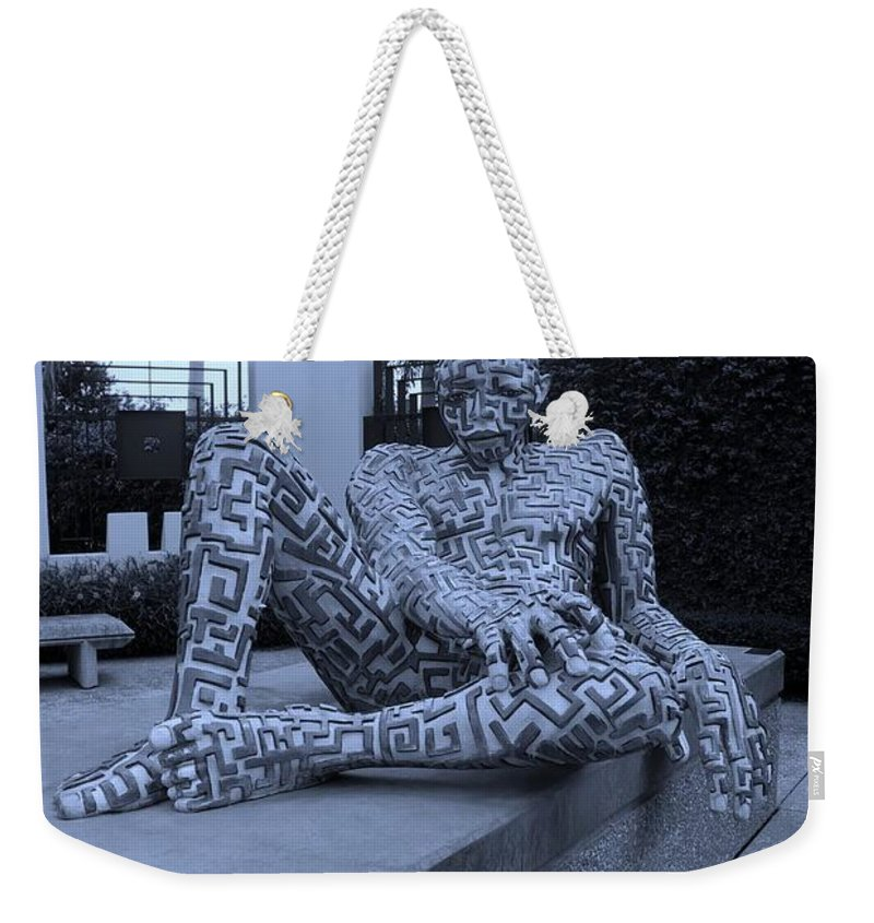 Maze Weekender Tote Bag featuring the photograph A Maze Ing Man Cyan by Rob Hans