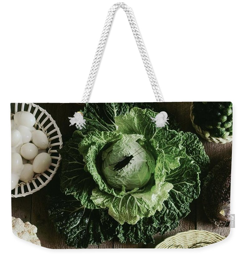 Decorative Art Weekender Tote Bag featuring the photograph A Mixed Variety Of Food And Ceramic Imitations by Fotiades