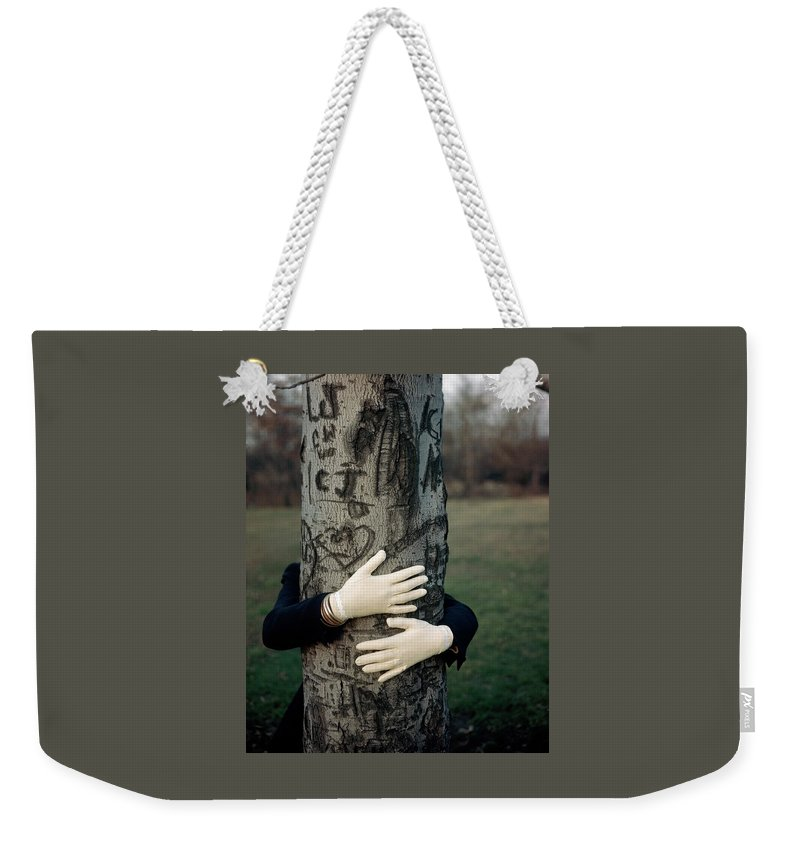 Fashion Weekender Tote Bag featuring the photograph A Model Hugging A Tree by Frances Mclaughlin-Gill