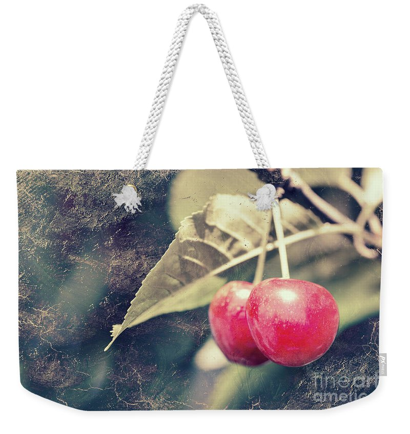 Cherries Weekender Tote Bag featuring the photograph A Pair Of Cherries by Linda Lees