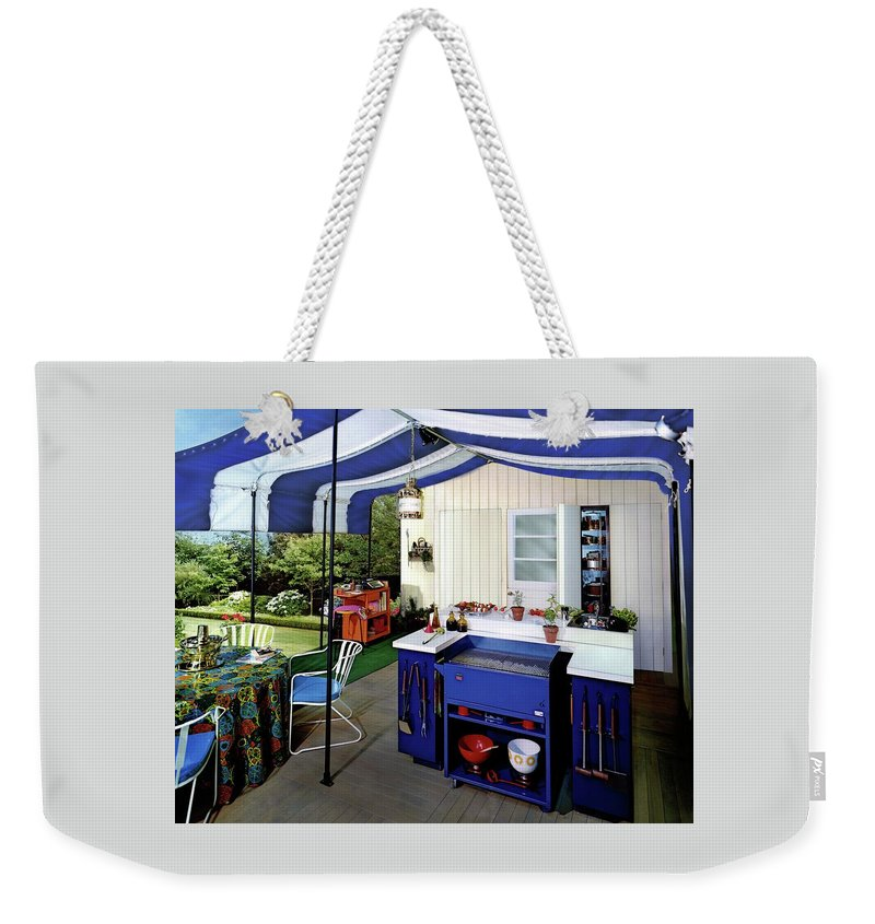 Architecture Weekender Tote Bag featuring the photograph A Patio by Pedro E. Guerrero