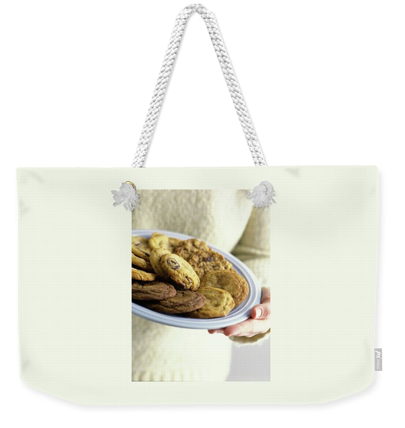 Cooking Weekender Tote Bag featuring the photograph A Plate Of Cookies by Romulo Yanes