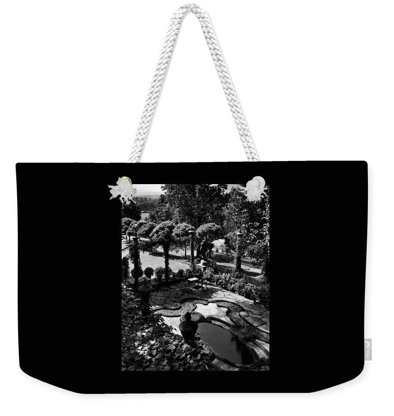 Garden Weekender Tote Bag featuring the photograph A Pond In An Ornamental Garden by Gottscho-Schleisner