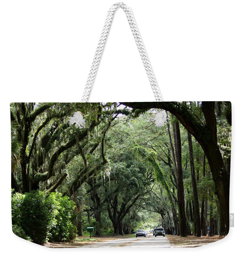 A Pretty Tree Covered Road Somewhere On Hilton Head Island Weekender Tote Bag featuring the photograph A Pretty Tree Covered Road Somewhere On Hilton Head Island by Kim Pate