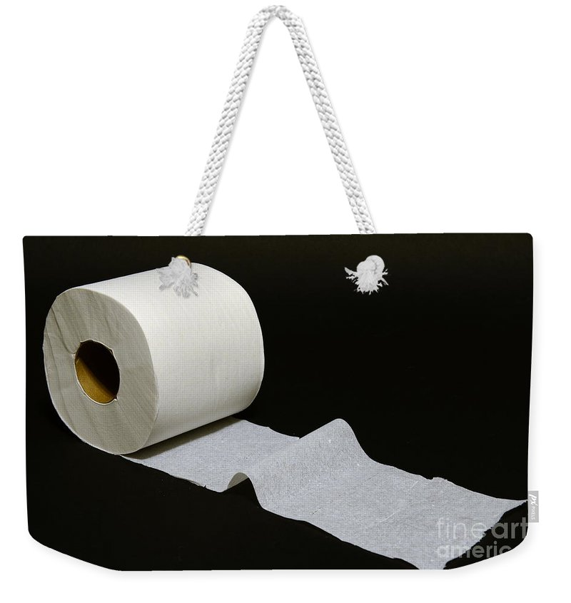 Paul Ward Weekender Tote Bag featuring the photograph A Roll Of Toilet Paper by Paul Ward